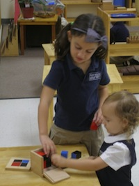 Two primary students working with the Binomial Cube.