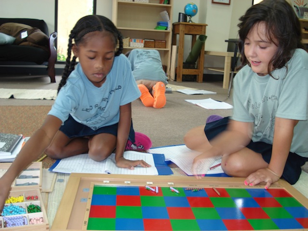 Elementary students working with the checkerboard.