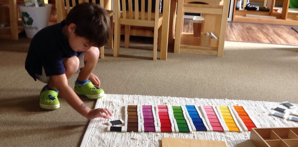 Primary student working with color box material