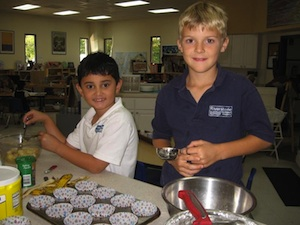 Elementary Students cooking.