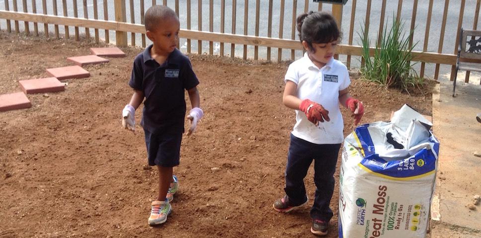 Primary students starting their courtyard garden