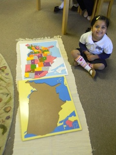 Primary student working with US puzzle map.
